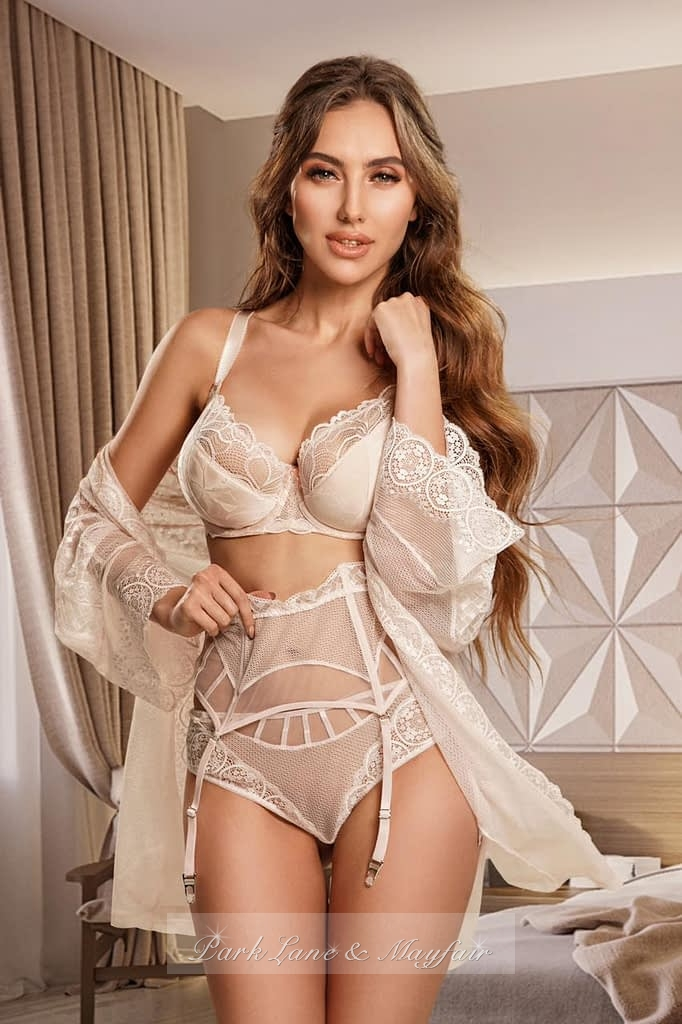 Candice in her elegant lingerie set and white gown