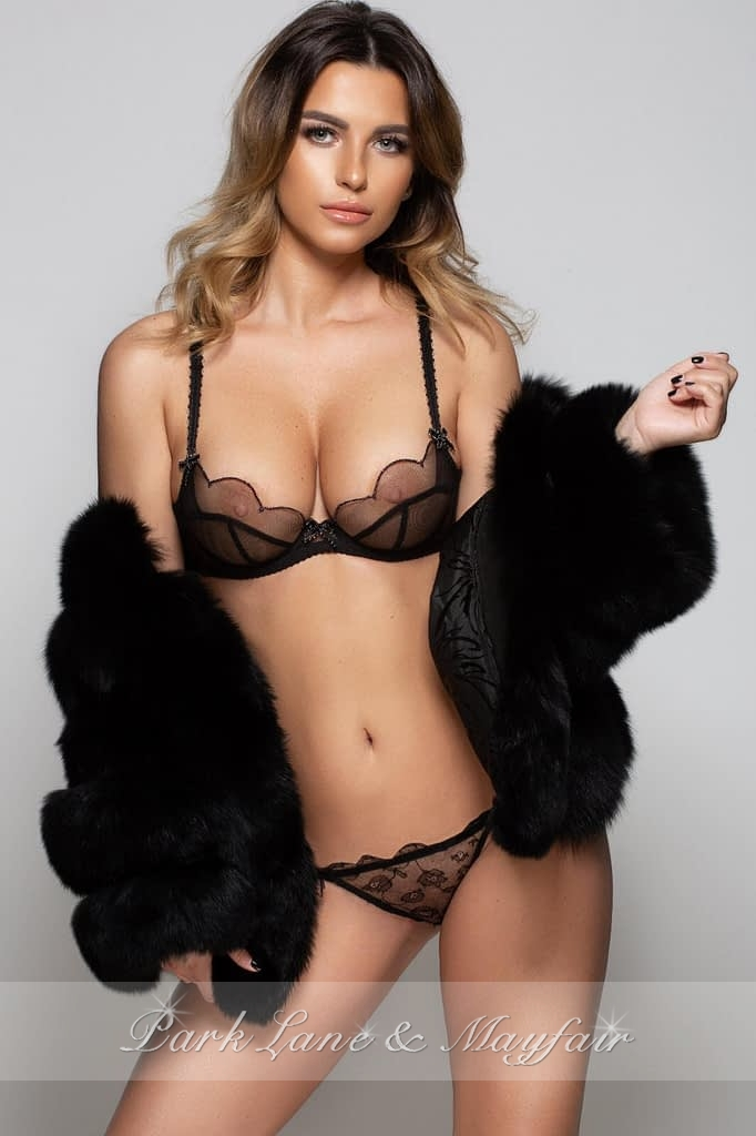 Beautiful London escort Monique showing off her sexy figure and model looks