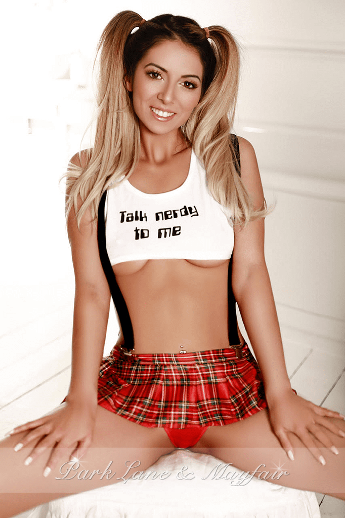 Angelique sitting in little sexy schoolgirl outfit