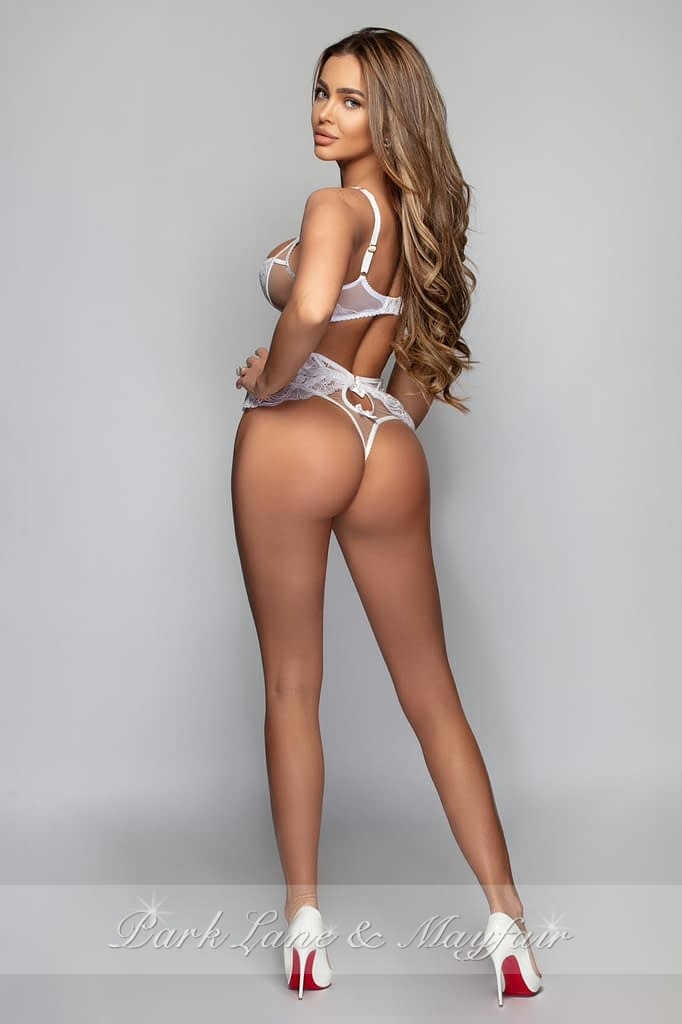 GFE escort Gisella with her back to the camera showing off her perfect bottom