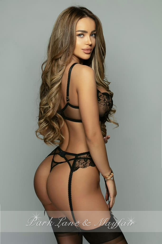 High end callgirl Gisella with her long hair and tanned skin