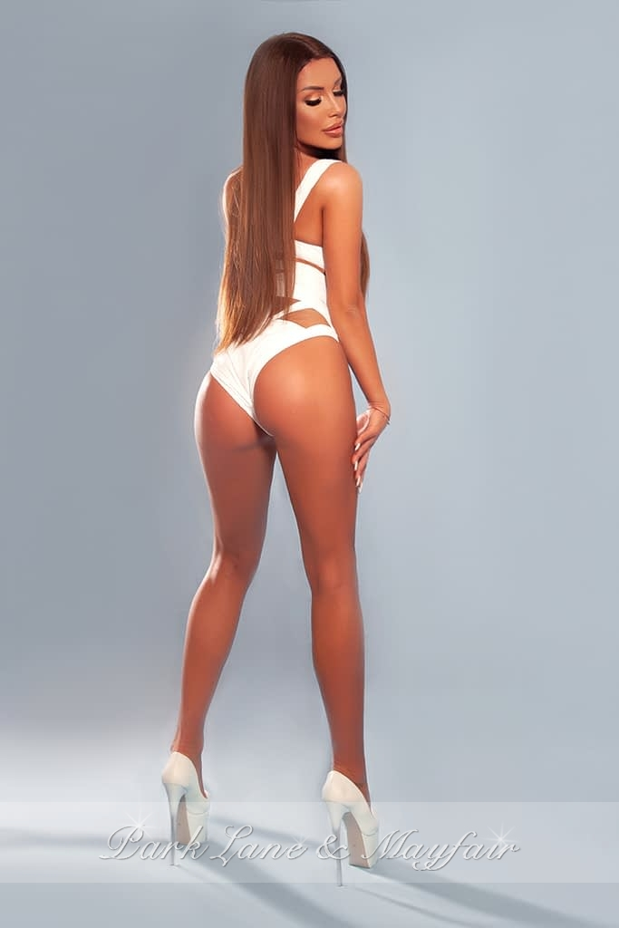 High end London escort Anouk showing off her gorgeous petite figure