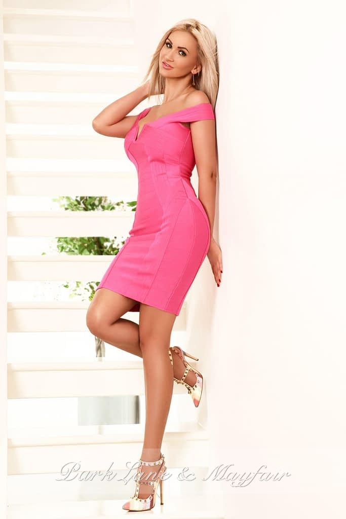 A photo of Chantelle wearing an elegant pink dress and heels