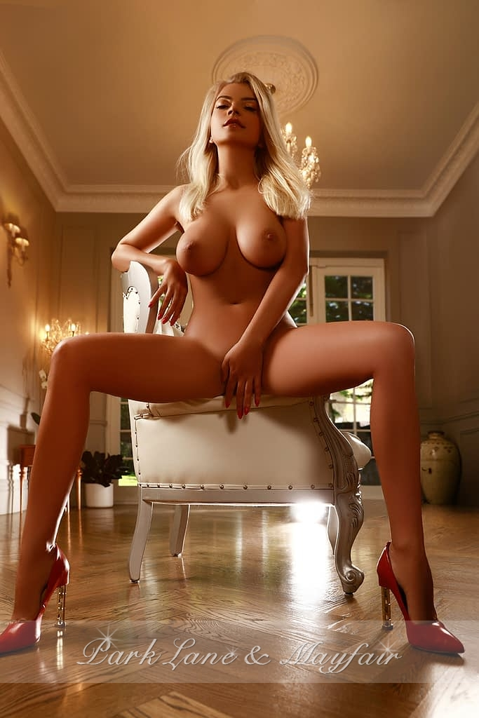 Naked escort Tina sitting on a chair