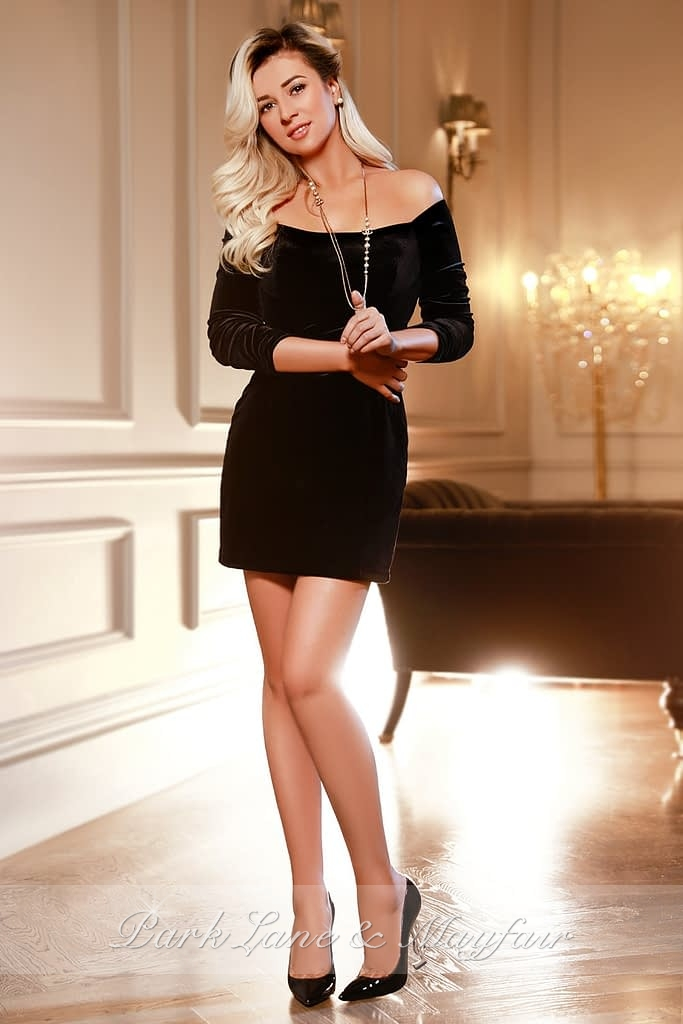 Escort Charlotte in a little black dress