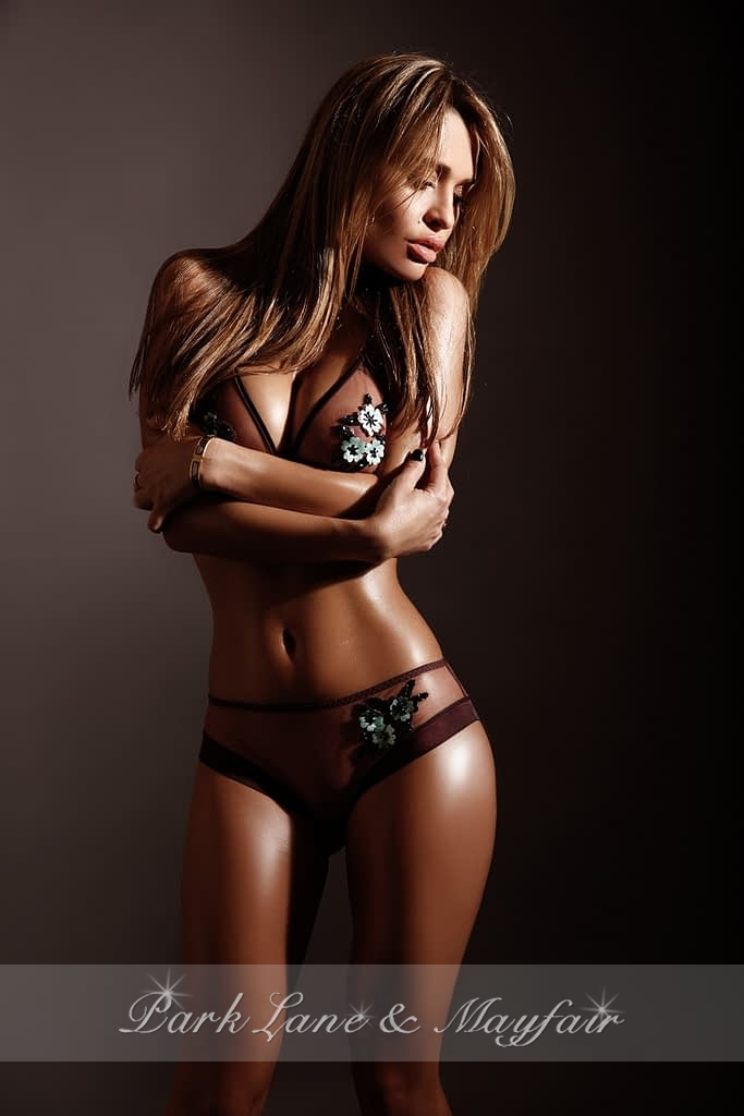High end London escort Ally showing off her gorgeous petite figure