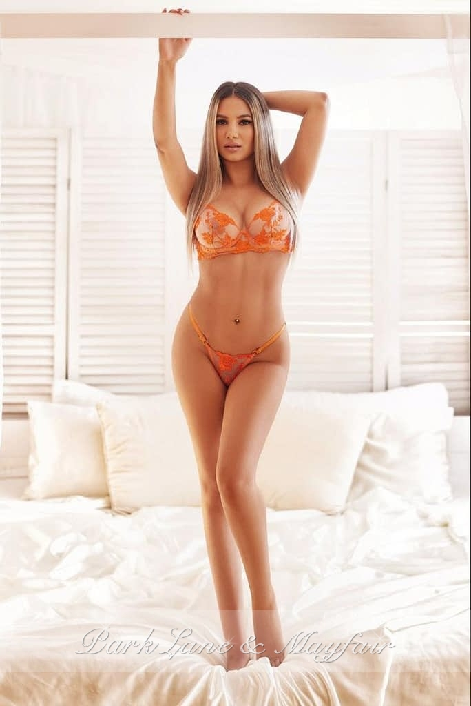Sexy London escort Katherine showing off her gorgeous toned figure