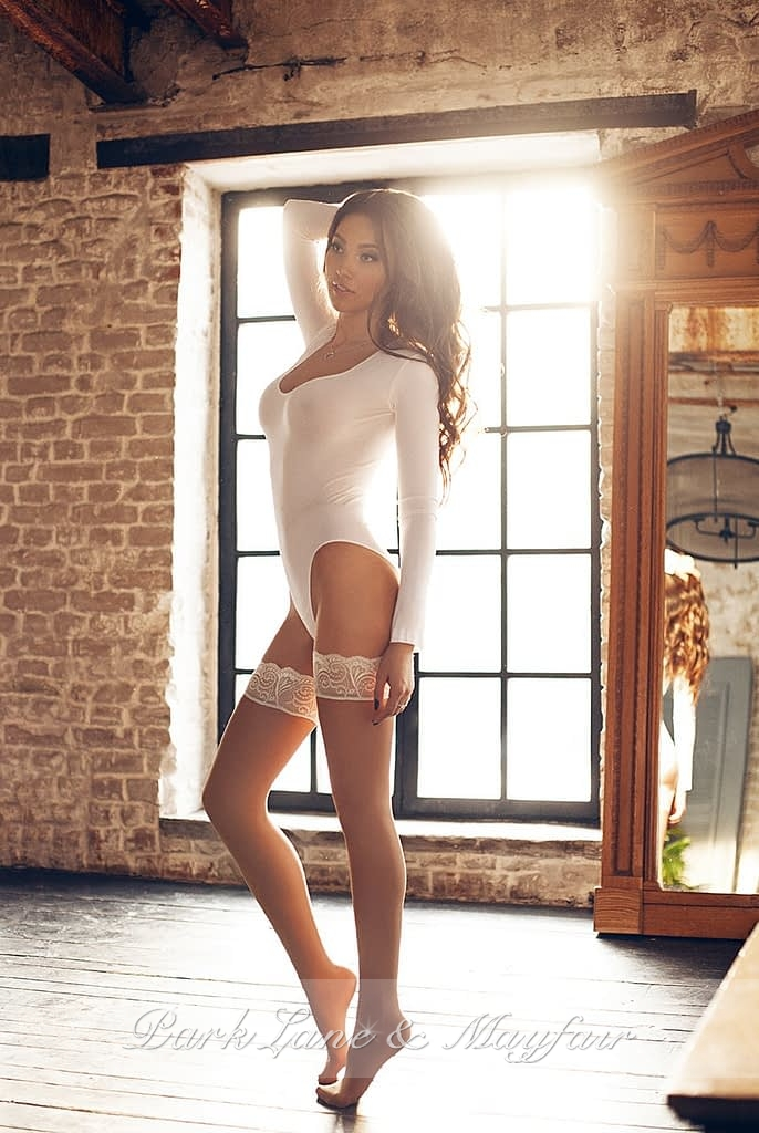 High end escort Veronica in her white lingerie and stockings