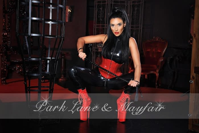 Heather dressed in her naughty little black leather outfit