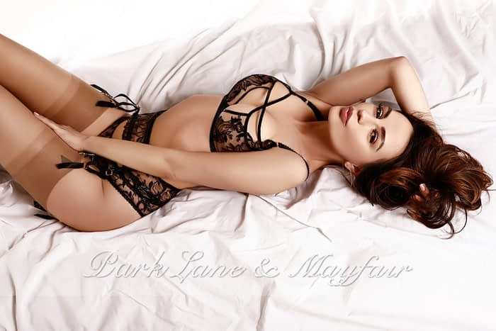 Erin on white sheets in her expensive lingerie