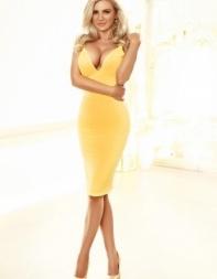 London hottie Priya in her yellow dress.