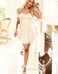 Sexy escort Suri in her little white dress.