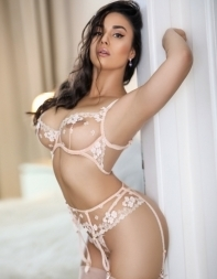 Elite London escort Etta in white lingerie