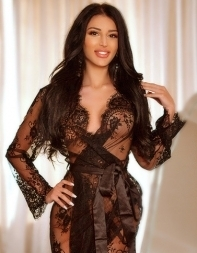 Party girl escort Dakota in black lace negligee