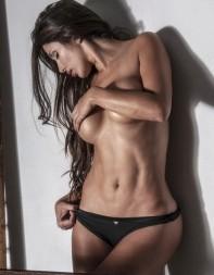 Escort Evangeline in just her knickers with her long dark hair
