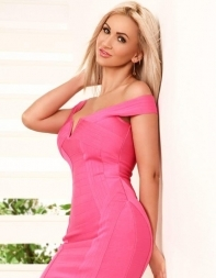 busty blonde escort Chantelle in pink dress