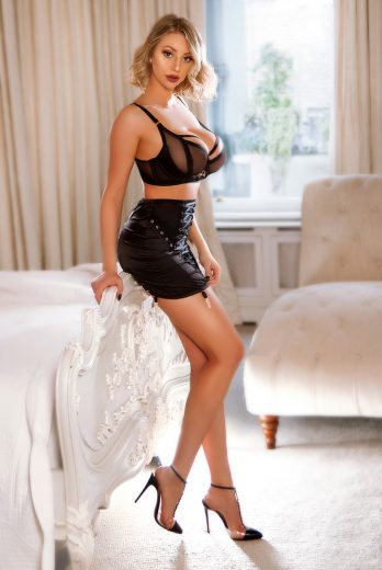 Sexy high end London escort Gaby in her black skirt and bra