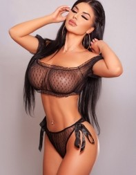 Busty Hayley with her long brunette hair and see-through underwear
