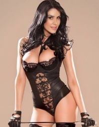 High end escort Latoya in black lingerie holding a whip