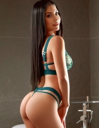Elite London escort Shirley in her sexy green lingerie.