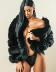 Escort Audrey in black fur coat