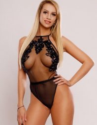 Blonde escort Mildred in sheer black bodysuit