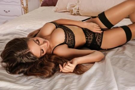 Best Belgravia London escort Candice lying on the bed